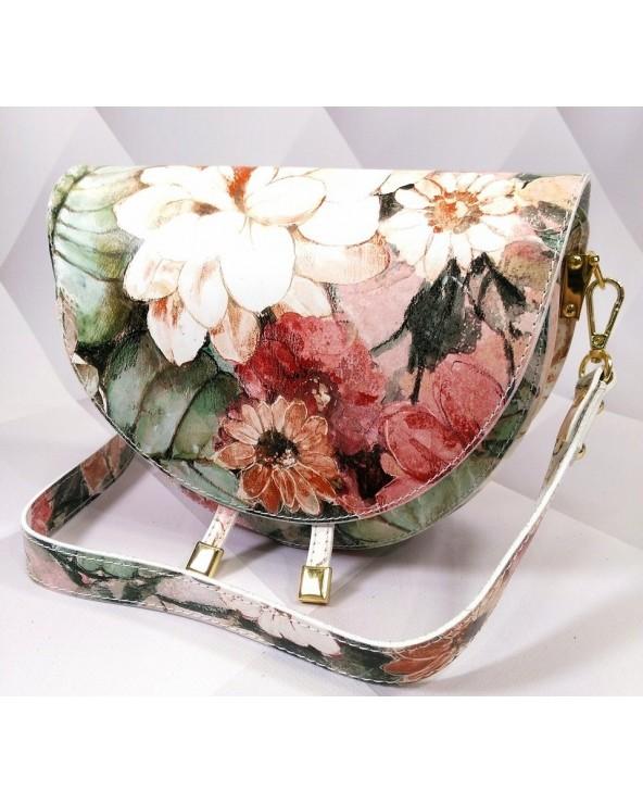 Owalna torebka z szerokim paskiem w kwiaty